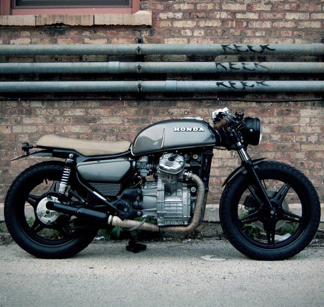 Beautifully rebuilt 1978 Honda CX500 (cafe racer style; beige saddle on charcoal gray).