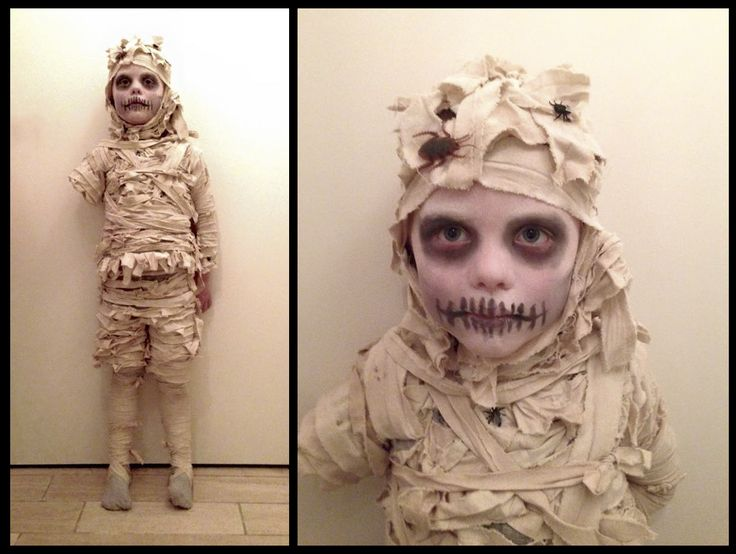 My diy mummy costume for my son. An old bed sheet dyed with tea., torn into strips and sewn onto old shorts, long sleeved t-shirt and a balaclava.                                                                                                                                                     More