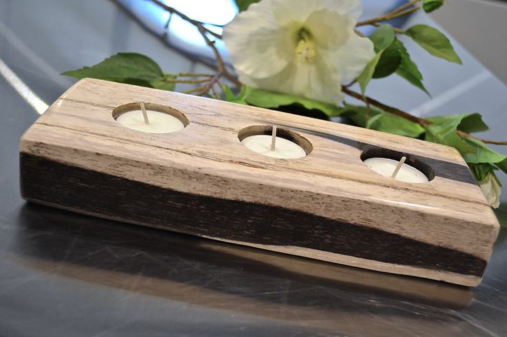 Chandelle Galerie-Teak wood tea light holders.