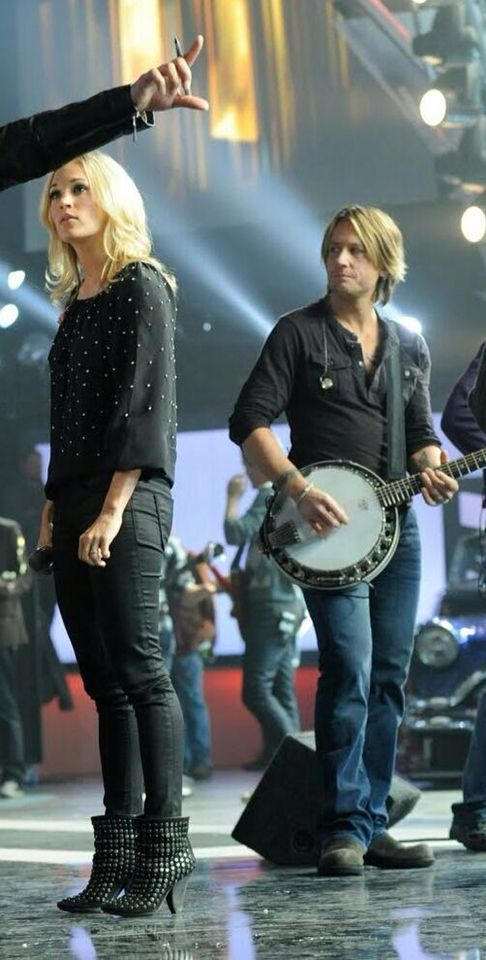 Carrie in rehearsals (Keith rehearsing, playing banjo for her performance that night)