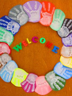 Simple painted wreath of children's handprints for Welcome