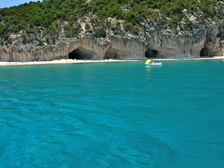 The beach of Cala Luna is the most famous of the beaches in Orosei Gulf its name derives from its crescent moon shape with incredible turquoise water, pure and transparent - Sardinia