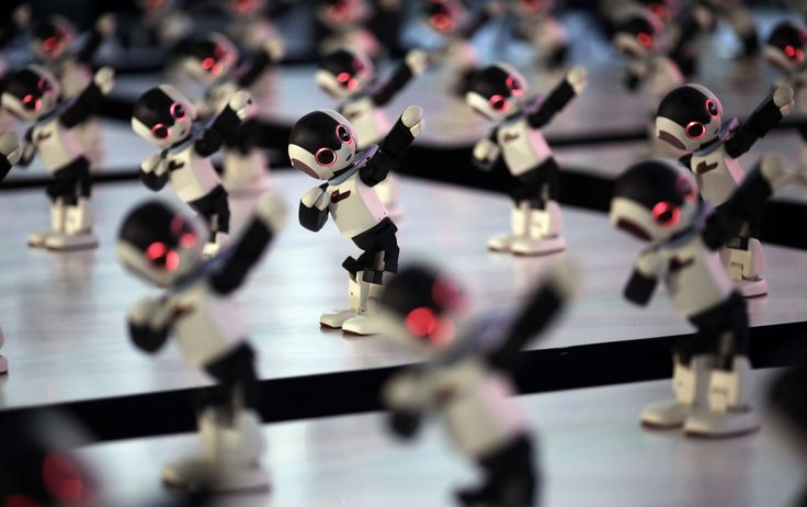 Tokyo, Japan 100 bodies of Robi prefabricated humanoid robots perform during the launch of its DIY weekly magazine that comes with the robot kits. The 13.4in-tall robot can recognise more than 200 Japanese phrases, walk, dance and kick a ball