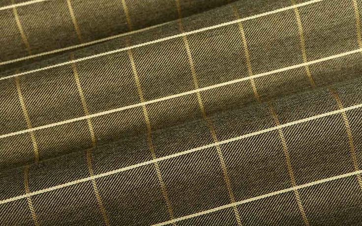 Bring out Reflection's geometric pattern with Big Grid Outdoor Upholstery Fabric. This charcoal fabric has subtle green and gold undertones and a large-scale pattern. The 100% Sunbrella Acrylic works for indoor and outdoor upholstery projects. This American-made fabric is available at $68 per yard.