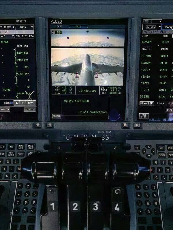 VIEW FROM THE TAIL: The flight crew observes their flight profile from an on board camera located in the aircraft's empennage . . .