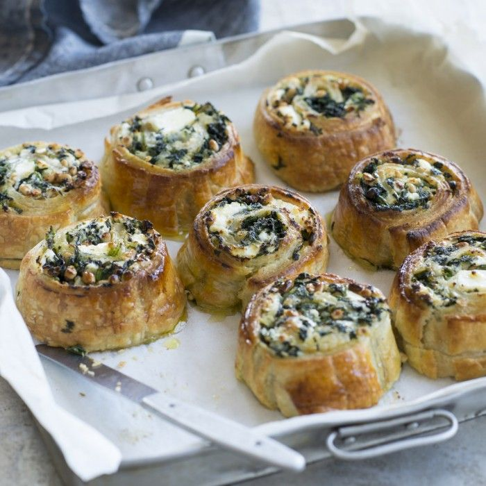 A delicious pastry roll full of spinach, feta and pine nuts.