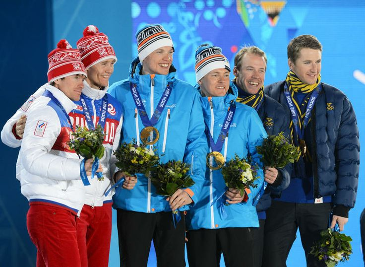 DAY 13:  (L-R) Silver medalists Maxim Vylegzhanin and Nikita Kriukov of Russa, gold medalists Iivo Niskanen and Sami Jauhojaervi of Finland and bronze medalists Emil Joensson and Teodor Peterson of Sweden during the medal ceremony for Cross-Country Skiing Men's Team Sprint Classic http://sports.yahoo.com/olympics