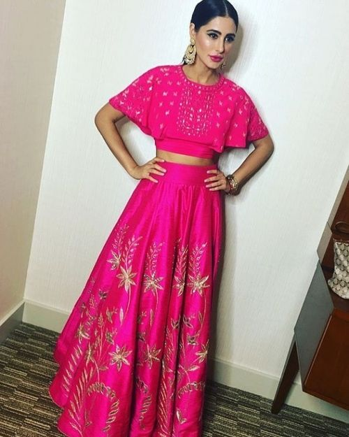 Nargis Fakhri in a gorgeous outfit by Anita Dongre #anitadongre #indianclothes #pinklehenga