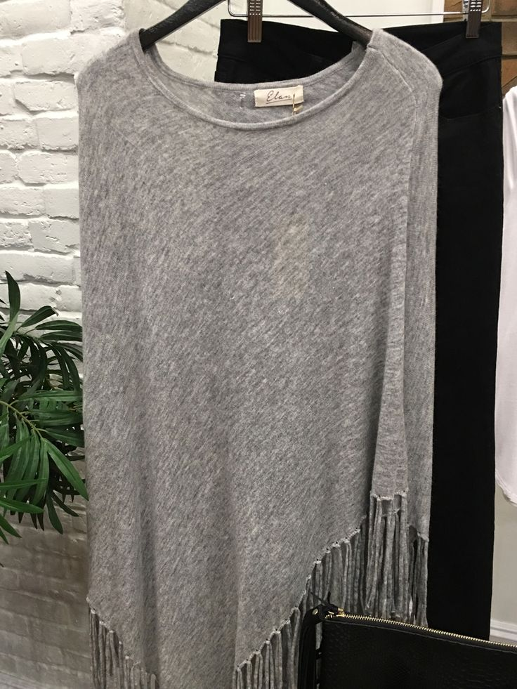 A lovely heather gray poncho. $80 Add this to any outfit causal or dressy and it keeps you warm and hot! #ShopALB #TownSquareLV