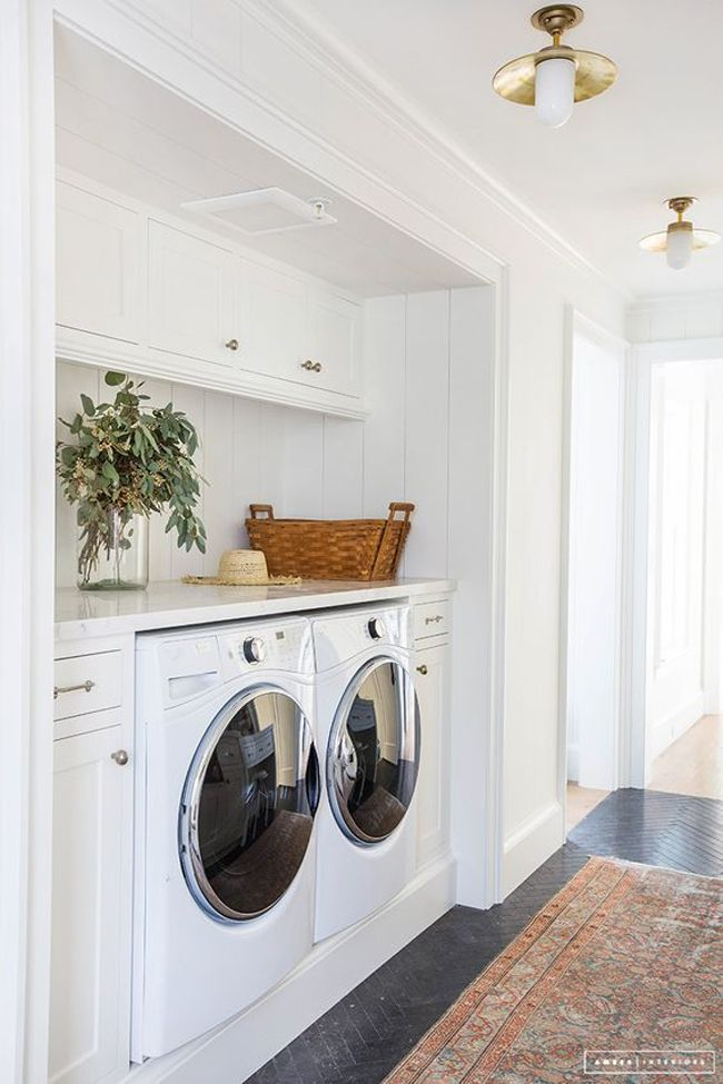 cute hallway laundry room built-in! Short on space, but want more of that completed laundry room feel? Take a look at this perfect space-saving laundry room idea built into a hall closet. Every front loading washer and dryer needs a folding surface and cabinet storage left and right! Dream laundry room for a small house