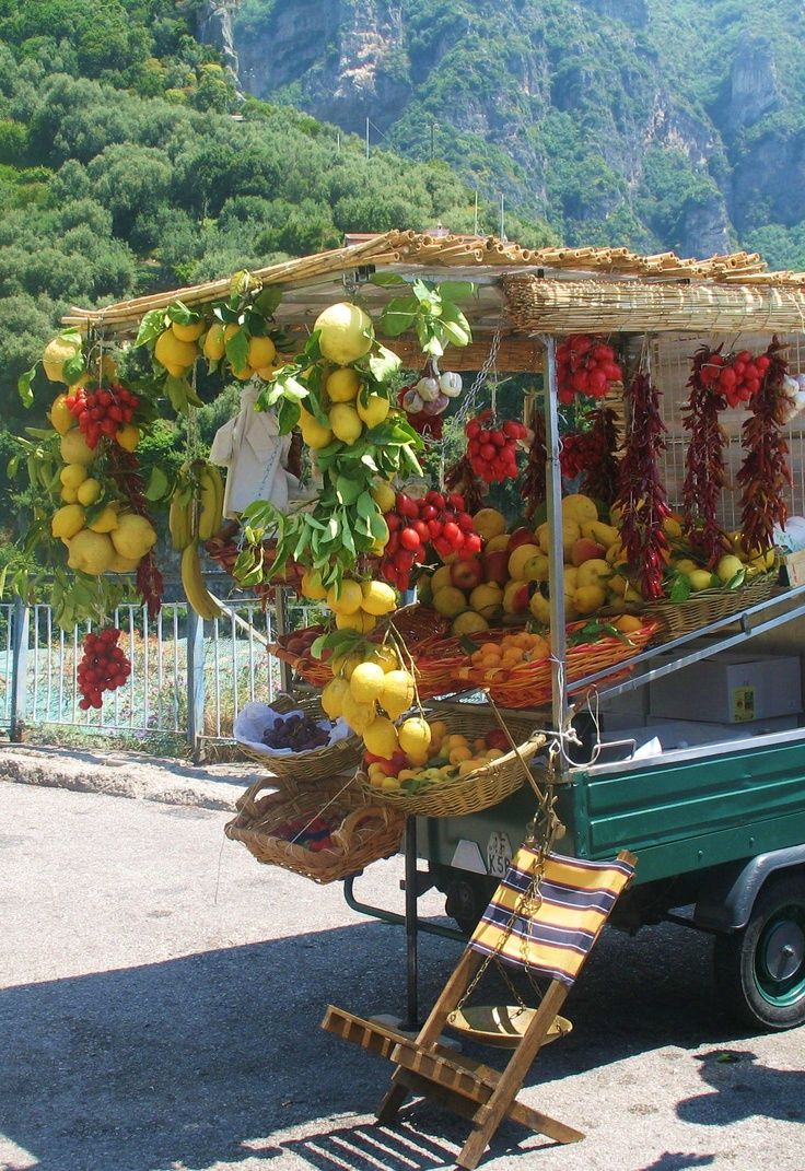 a fruit stand in Sicily , Italy
