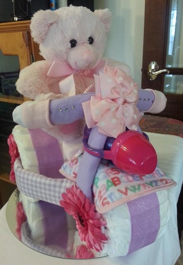 <3 My First Tricycle <3   Shalea Design - Nappy Cake  Baby Shower / New Baby Gift  Contains - 38 Infant Nappies  2 x Fleece Winter Wraps  1 x Baby Bonnet  1 x Baby Feeding Bib  3 x Baby Wash Cloths  2 x Baby Stocking Socks  1 pair Baby Socks  1 x Pink/White Bow Hair Clip  1 x Pink/Purple Sippy Cup  1 x 35cm Plush Pink Teddy Bear  1 x Silver Cake Tray   Decorated, Embellished, Finished with Cellophane & Ribbon  Custom Made to Order   Boy, Girl or Unisex Colours   $90.00