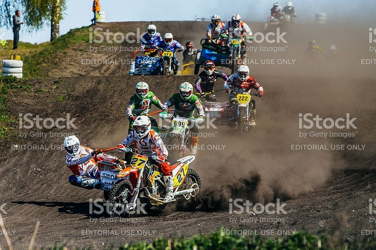 Miasskoe, Russia - May 02, 2016: group of motorcyclists with sidecars riding along a dusty track during Cup of Urals motocross