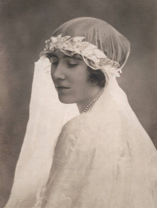 Elizabeth Bowes-Lyon, later Queen consort of Great Britain as bridesmaid of Princess royal Mary. 1922