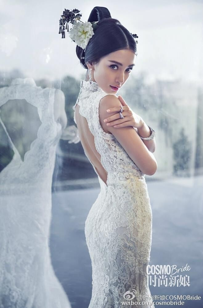 Beautiful pairing of this lovely white lace wedding gown with a modern take on traditional Chinese bridal hair accessories as seen on Angelababy for COSMOBride.