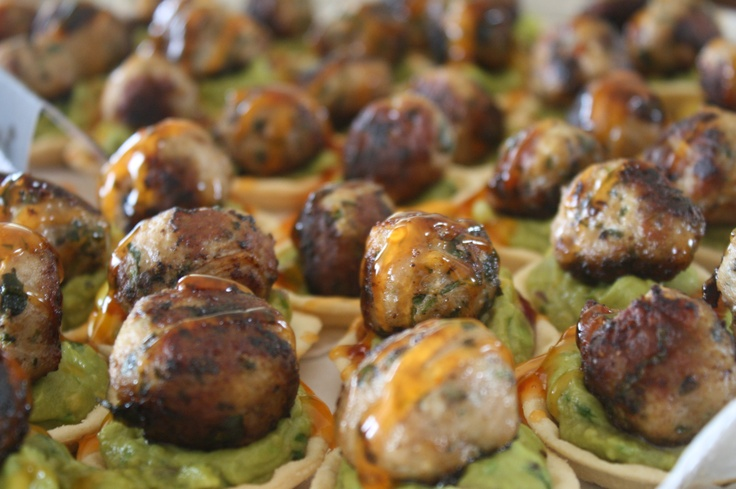 Spicy pork balls with guacamole in baby pastry cups