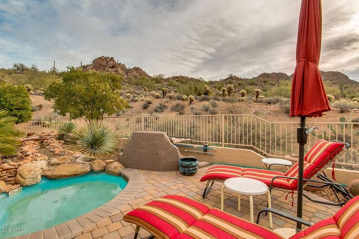 Southwestern Hot Tub with exterior tile floors, Fence