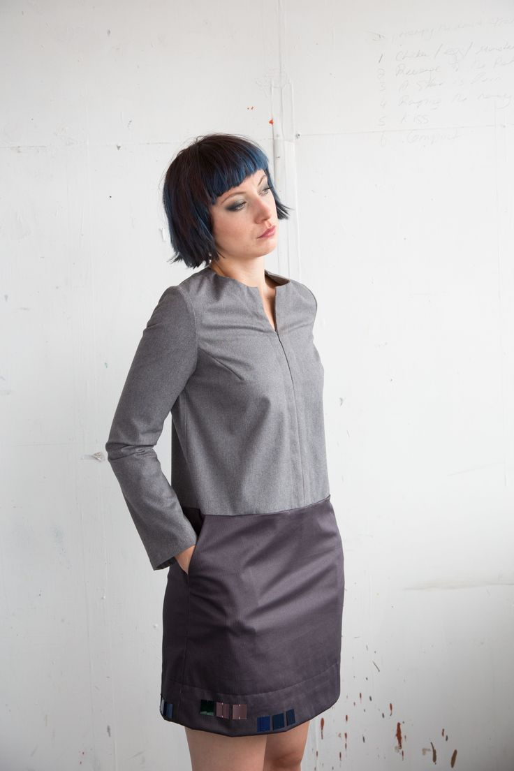 Dress  Relaxed fit with long bell sleeves dress in combination of grey cotton and navy stretch-cotton. Conceal zip closure at front. Square sequins at the hem. Cotton 95% Elastin 5%