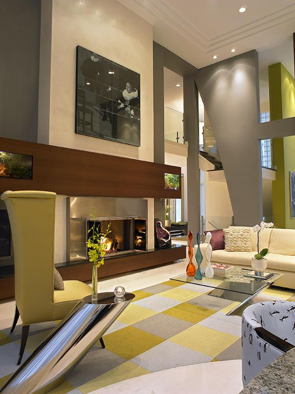 Asymmetrical Detailing Including Architectural Wall Cutouts And Gleaming Tables Adds To The