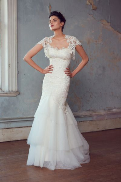 Strapless Karen Willis Holmes gown with a lace short-sleeve jacket: http://www.stylemepretty.com/2014/11/03/21-of-our-favorite-lace-dresses/