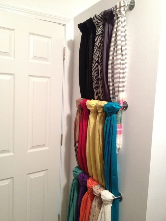 smart ways to store scarves: Got a lot of scarves?  Go ahead and cover the door (or the wall behind it) in staggered, lightweight rods. via solidparachute.tumblr.com