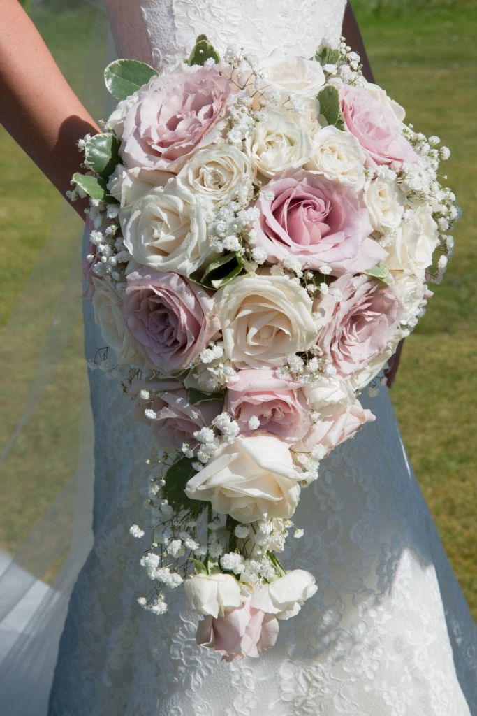 A luxurious teardrop shaped bouquet of premium cream 'Vendela' roses, cream spray roses 'majolica' very palest pink/nude 'quicksand' roses, gypsophila and pittisporum. The bouquet will be designed in a specialist oasis holder to create this very pretty shape. The handle bound with pretty cream ribbon. pollen flowers brighton www.critchlowphotography.co.uk