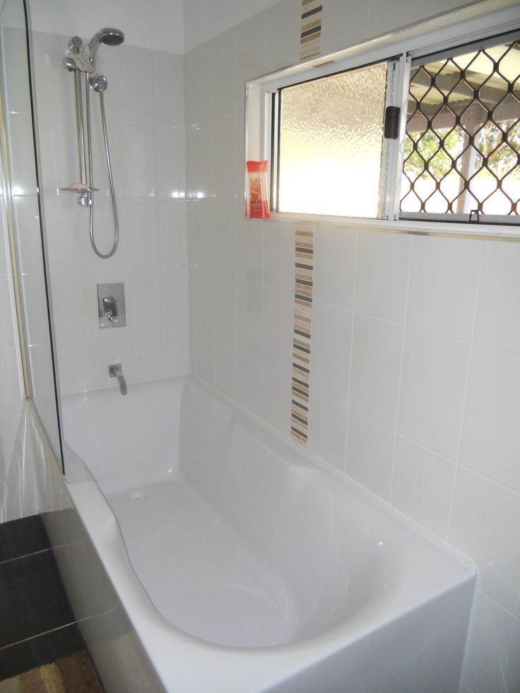 A corner freestanding bath with a bath screen and shower for Great small bathrooms
