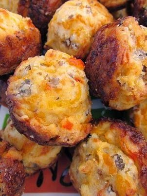 The Best Recipes In The World: CREAM CHEESE SAUSAGE BALLS.     Recipe)  1 lb hot sausage, uncooked8 oz cream cheese, softened1 1/4 cups Bisquick4 oz cheddar cheese, shredded Preheat oven to 400F.  Mix all ingredients until well combined. (I use my KitchenAid mixer with the dough hook attachment) Roll into 1-inch balls. Bake for 20-25 minutes, or until brown.