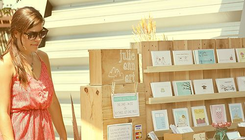 Great way to show case cards & prints at a show. Looks like a corner piece of trim attached to the back wall. Easy Peasy.