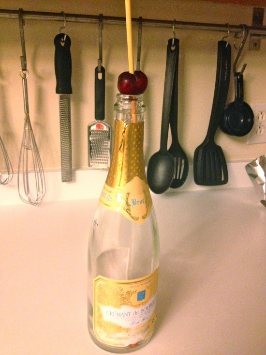 Easy Way to Pit Cherries... place on top of bottle and poke with a ...
