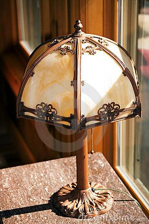 Oldest Antique Tiffany Lamp | An Antique Tiffany Style Lamp Sitting On A  Marble Top Table