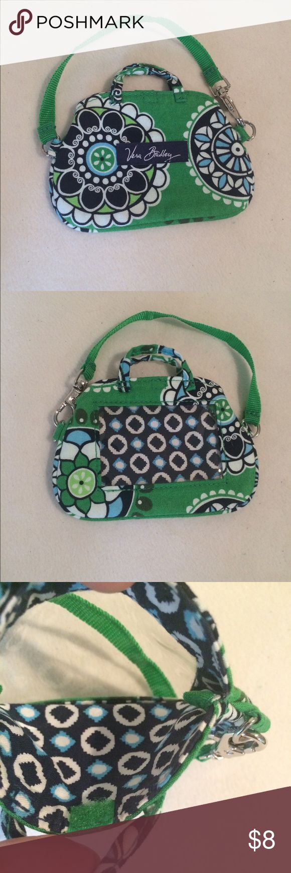 Vera Bradley Zip ID Case Reasonable offers considered 🛍 Bundle 2 or more items and save! 🎁 Bundle 5 items and I will reimburse the shipping fee 🎉. Cupcakes-Green pattern. Zippered close. 4.5 inch length, 1 inch width, 3 inch height. Strap attached. Preloved and in good condition. Vera Bradley Bags