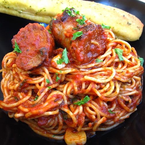 Sausage with Tomatoes and Garlic Placed on Spagetti