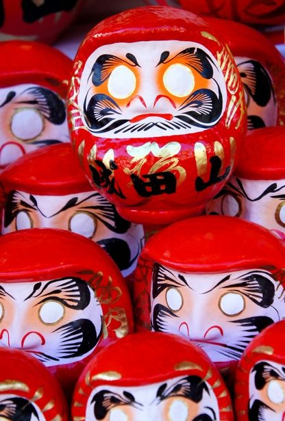 Japanese Dharma dolls - Daruma dolls are seen as a symbol of perseverance and good luck, making them a popular gift of encouragement in Japan.