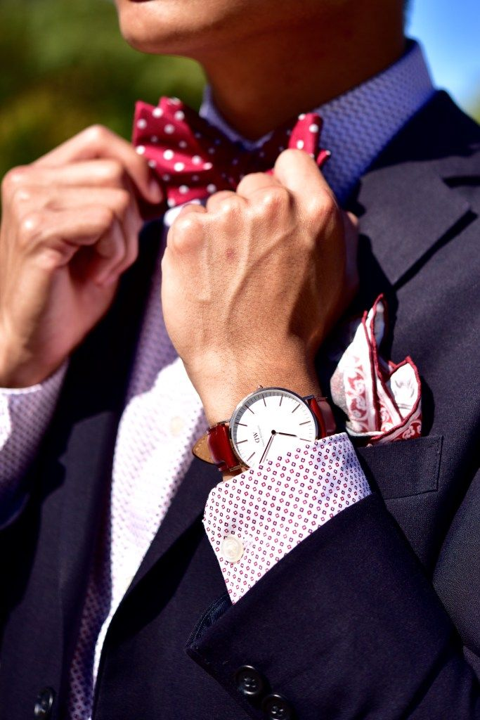 Red and silver bow tie paired with a navy blue suit.