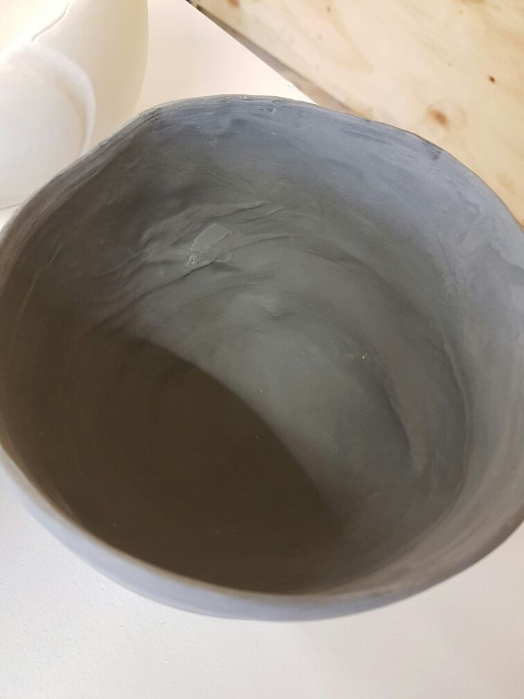 Sound Bowl, black porcelain, slip casted, fell out of mold.