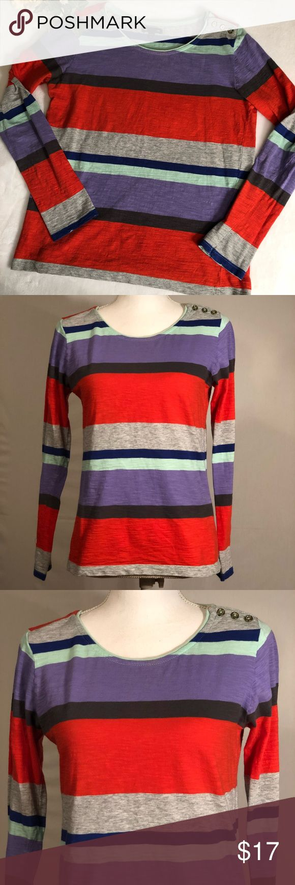 "Gap Colorful Graphic Stripe Button Tee Gap Colorful Graphic Stripe Button Tee. Colorful, graphic stripes. Gray, blue, aqua, purple, and coral. Round neckline with cut gold tone button detail on left shoulder. Long sleeves. Stretchy cotton knit material. Size medium. EUC, excellent used condition. No flaws. Measurements taken laid flat. 15"" shoulder width, 18"" bust, 24"" length. GAP Tops Blouses"