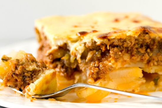 """Moussaka - a Greek """"lasagna"""" with potatoes, eggplant, spiced ground beef and cream sauce.  Sounds flavorful, yum!"""