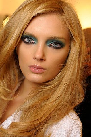 Turquoise eye makeup at gucci spring 2009 fashion show. Lead makeup artist Pat McGrath did a bold look with a rich metallic turquoise eyeshadow on the lid blended past the crease, a light green as a highlighter, lots of eyeliner and false lashes. She also highlighted the models' cheekbones and cupid's bow and added a soft pink lipgloss on the lips.