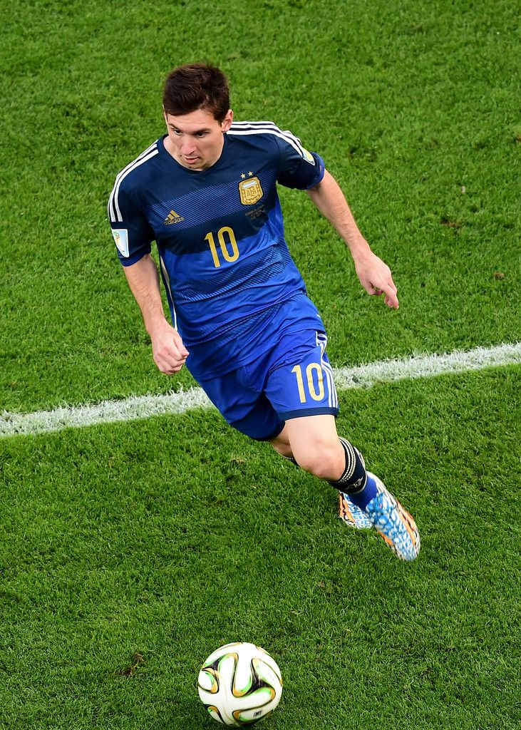 Lionel Messi Photos Photos - Lionel Messi of Argentina controls the ball during the 2014 FIFA World Cup Brazil Final match between Germany and Argentina at Maracana on July 13, 2014 in Rio de Janeiro, Brazil. - Germany v Argentina
