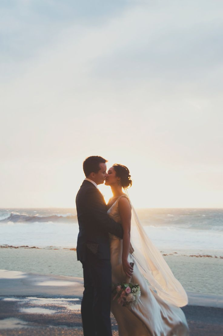 Bride and groom kissing at sunset Beautiful