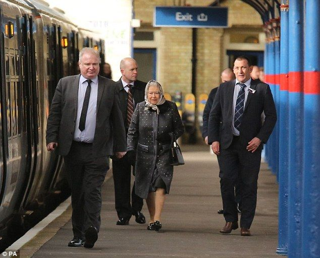 Accompanied by officials and station staff, Her Majestymakes her way along Platform 1 at King's Lynn station