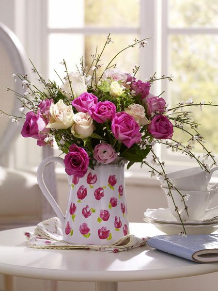 Pretty little pitcher with cut flowers.  Perfect for a breakfast nook or bath.  Too pretty.