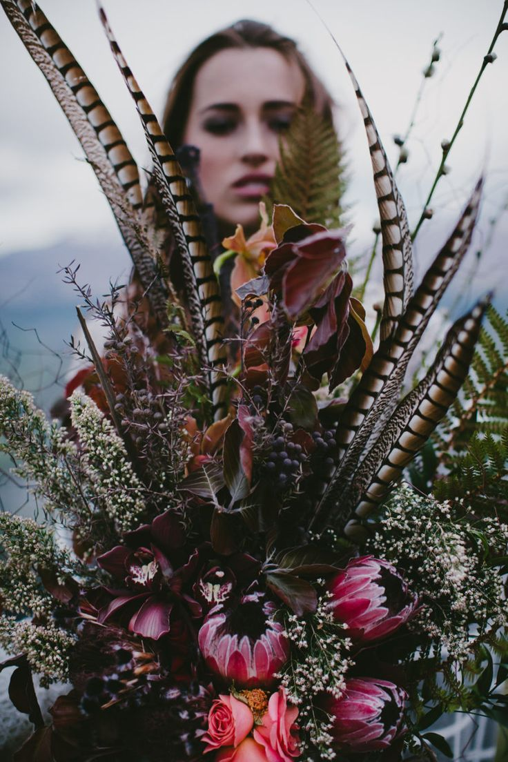 boho wedding bouquet with protea and feathers
