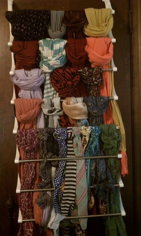 Soo need this!! Go to Target or Wal-Mart and buy one of these over-the-door shoe racks for about $20. Now, beautifully tie your favorite scarfs, tights, or beautiful fabrics onto each bar. Drape the excess into the middle, and hang over a door. You might actually wear all of your scarfs if you can see them properly. Finally, something not shower curtain style!!!