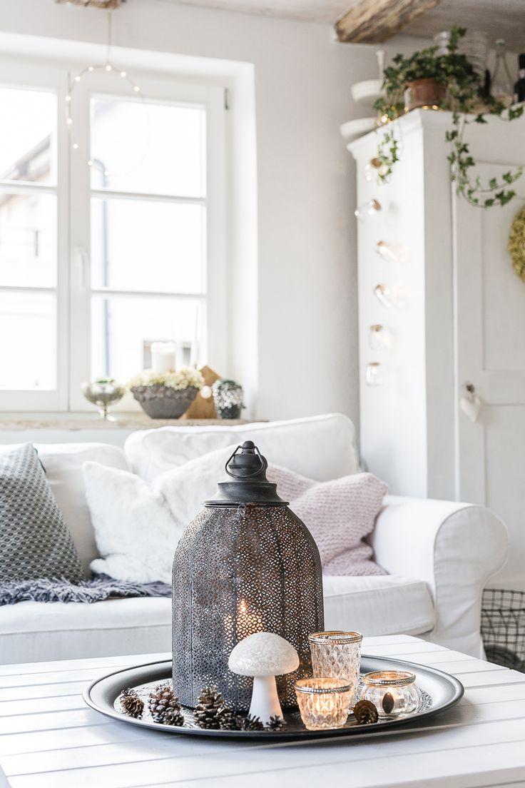 Hygge Home mit Laternen und Kerzen