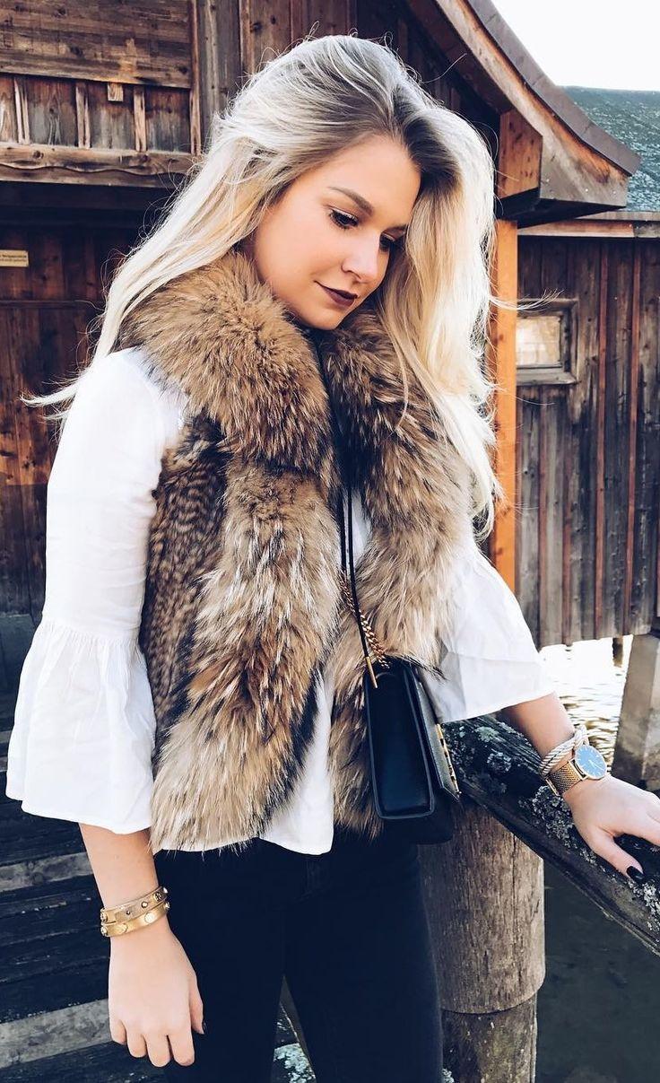 #winter #fashion //  Fur Vest // White Top // Black Skinny Jeans