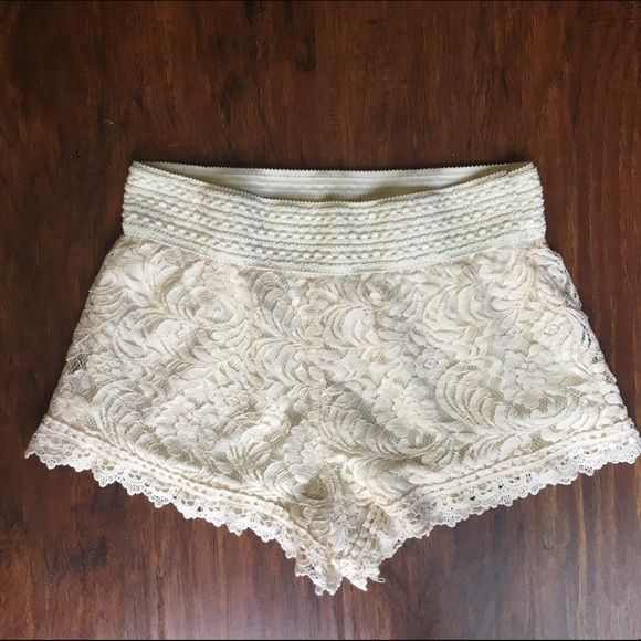 """Cream lace shorts Cute and sexy lace shorts. Perfect for summer! 2"""" inseam. Have a lot of stretch in the waist band so they're super comfy! Only worn once. The lining under the lace does occasionally peek out below the bottom of the lace but it's not very noticeable (pictured). Photo of black shorts is just to show how they fit (not included). Ambiance Apparel Shorts"""