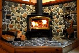 River rock wood stove hearth. We are doing this project now:)