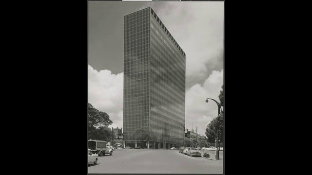 A film describing the development of International Style corporate architecture in the city of Melbourne, Australia. Spanning the period 1950-1980, the film charts the rise of the glass box, curtained walled office building and explores subsequent local developments of the the genre.
